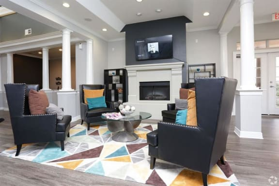 Resident lounge with fireplace at River Oaks Apartments, CLEAR Property, Texas, 75098