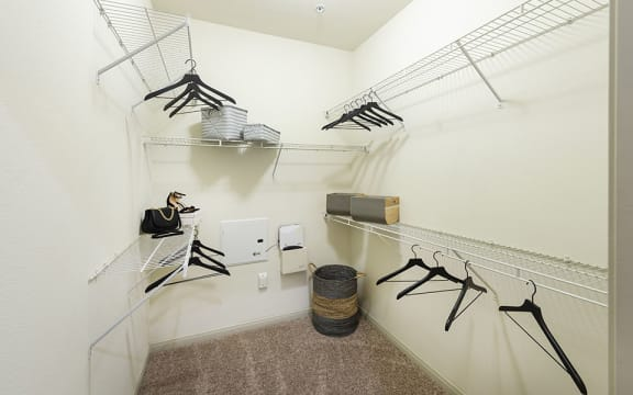 Walk-In Closets With Built-In Shelving at City Lake, Houston, Texas