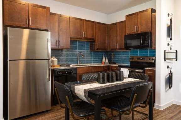 Parkside at Round Rock Apartments Model Kitchen and Dining Room Table
