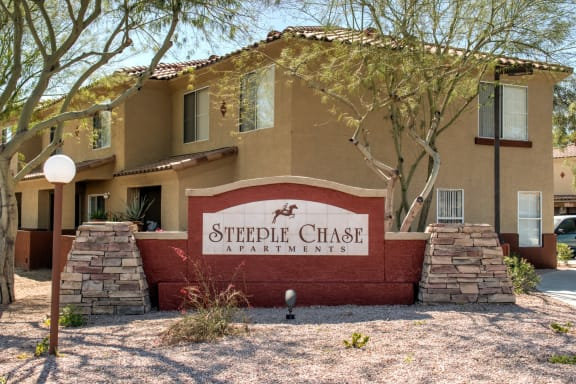 Steeple Chase Apartments Sign and Apartment Building