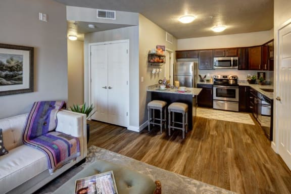 Living Room With Kitchen View at Alloy at Geneva, Vineyard, UT, 84058