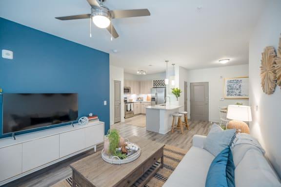 AzureCarnesCrossroads Furnished Model Interior Living Room/ Kitchen view