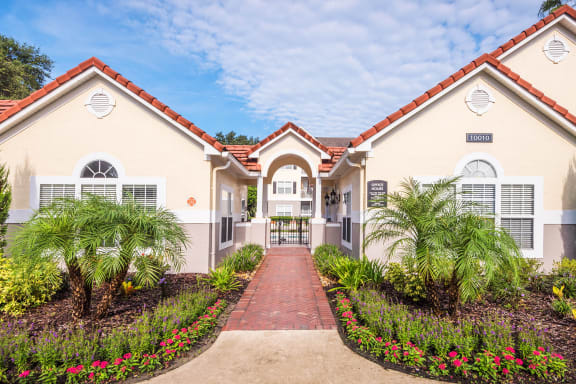 The Colony at Deerwood Apartments - Walkway to leasing office