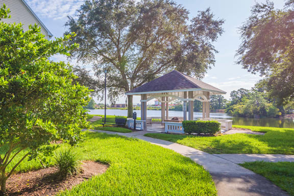 The Colony at Deerwood Apartments - Lakeside gazebo with fire pit and seating area