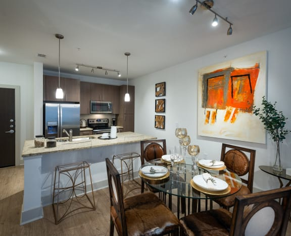 Upgraded Cabinets, Countertops, and Flooring at Everra Midtown Park Apartments Dallas