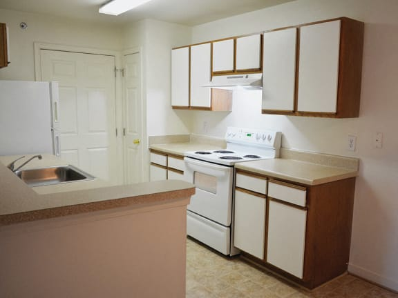 Kitchen space at Whispering Oaks Apartments in Portsmouth VA