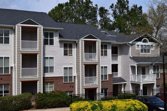 Residences with balconies at The Falls Apartments in Raleigh