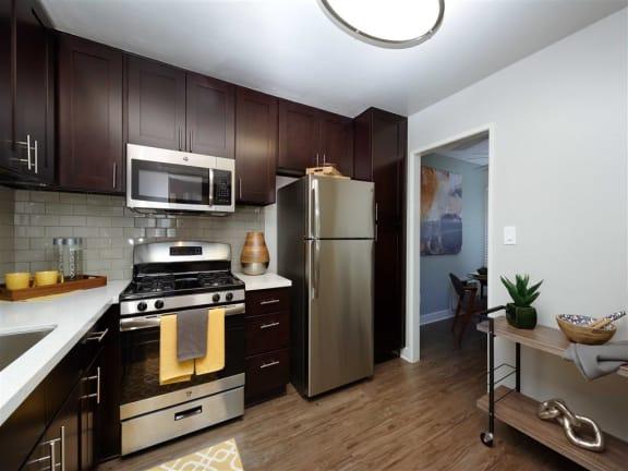 Gourmet Kitchens with Islands, Caesarstone Countertops, and Decorative Backsplash at The Verandas Apartments, West Covina, California