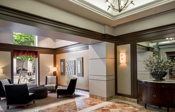 The Metropolitan's elegant lobby, with comfortable seating and marble flooring in Bethesda, Maryland.