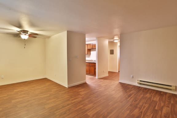 Spacious Model Floor Plan with Faux Wood Floors at Apartments Near Bremerton