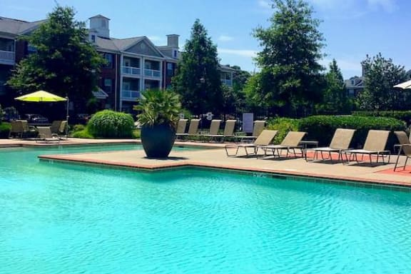 large pool with landscaping and bank of deck chairs at Centerville Manor Apartments, Virginia
