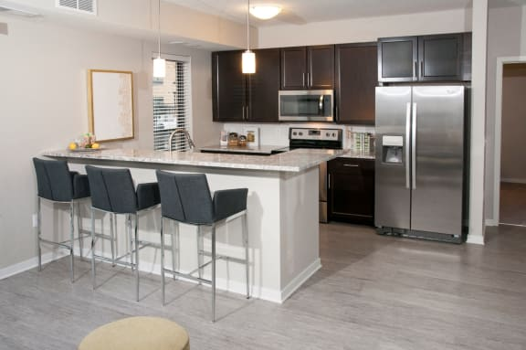 Select Newly Renovated Apartments with Open Kitchens, Granite Counter Tops and Stainless Steel Appliances
