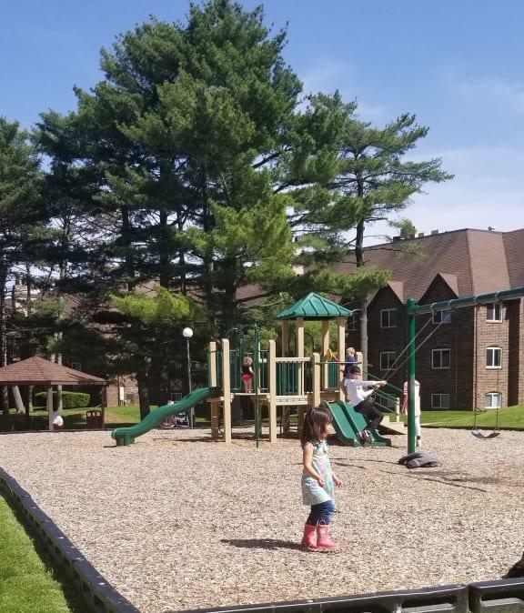 Tot Lot and Playing Field at Candlewyck Apartments, Kalamazoo, Michigan