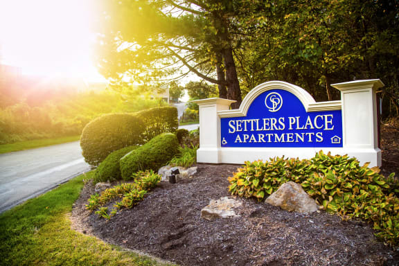 Settlers Place Apartments exterior sign