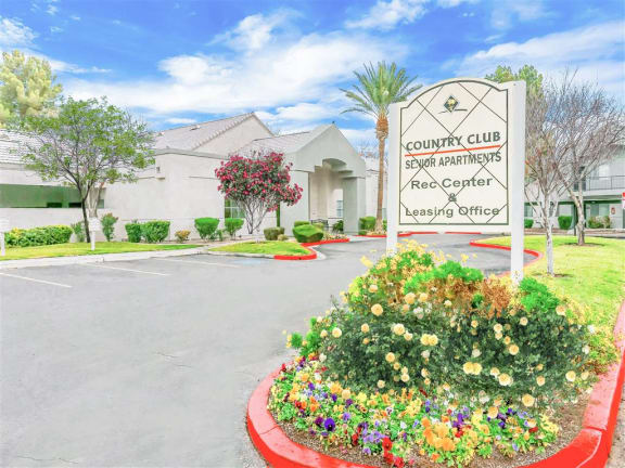 Curb appeal in front of Country Club at The Meadows Senior Apartments in Las Vegas, NV, For Rent. Now leasing 1 and 2 bedroom apartments.