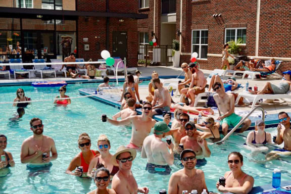 Image of Residents participating in a Greenway Pool Party at Greenway at Fisher Park, Greensboro, NC, 27401