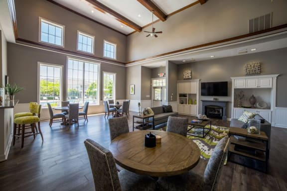 Tables and chairs in clubhouse at The Reserve at Williams Glen Apartments, 2201 Williams Glen Blvd, Indiana