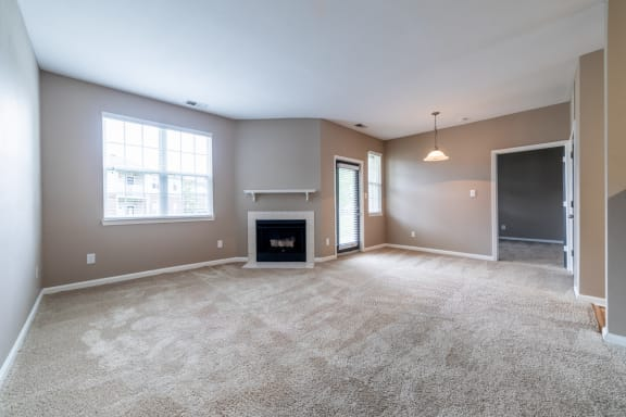 Living Room With Fireplace at The Reserve at Williams Glen, Indiana, 46077