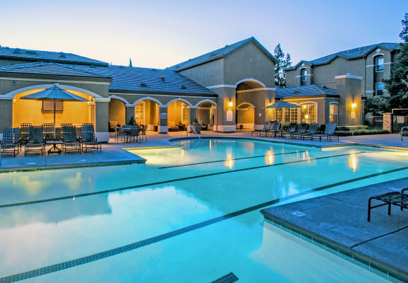 Rolling Oaks Pool at Dusk at Apartments near Me