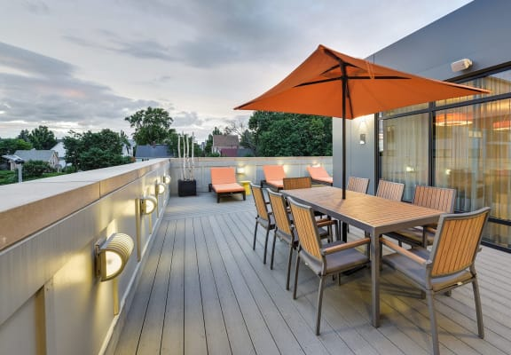 Rooftop Terrace with seating and dining space at Windsor at Maxwells Green, Somerville, MA