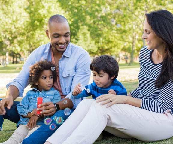 Family of Four blowing bubbles in the park | Casablanca in Palmdale, CA 93552
