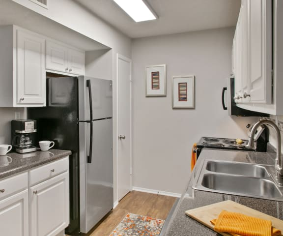 Chef-Inspired Kitchens Feature Stainless Steel Appliances at Crestview at Cordova, Pensacola, FL, 32504