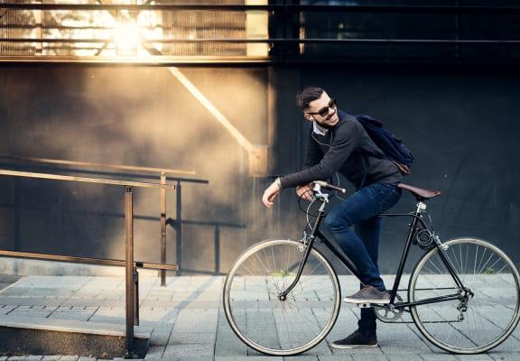 Guy in Sunglasses on a Bike