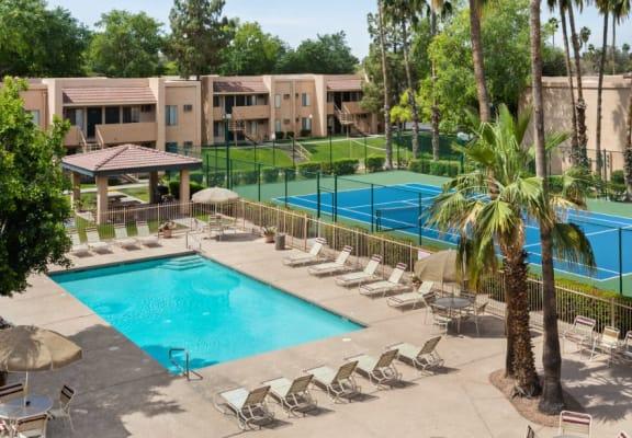 Pool, Pool Patio, Tennis Court & Exterior at Shorebird Apartments in Mesa, AZ
