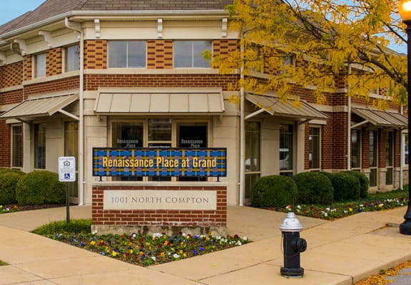 Leasing office exterior with property sign-Renaissance Place at Grand Apartments, St. Louis, MO