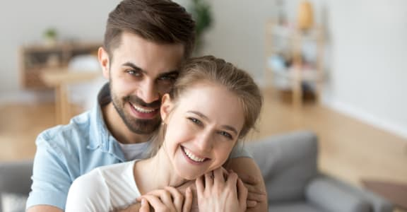 Couple Embracing in Living Room