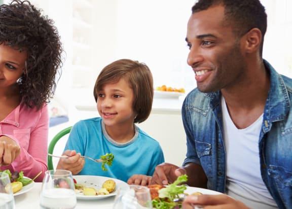 Family Having Dinner l Apartments in Victorville l Casa Bella
