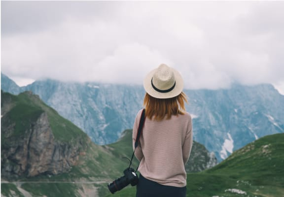 Woman Looking at Mountains at The Alloy at Geneva in Vineyard, UT 84058