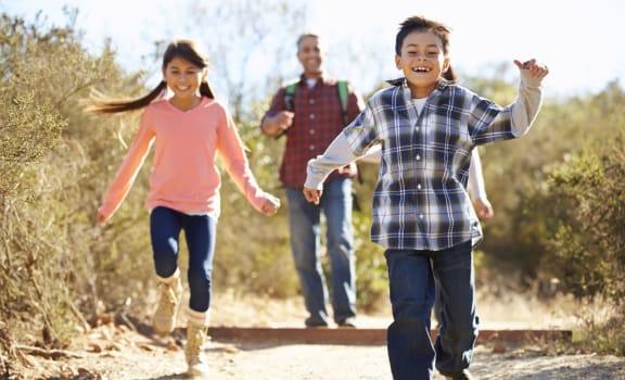 Happy family and kids hiking in Ramona