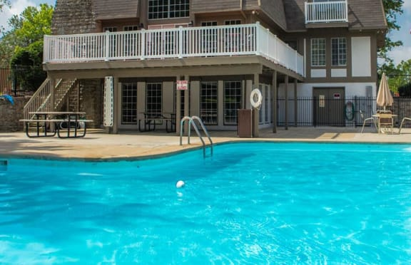 Resort style swimming pool with large sundeck at Camelot East Apartments in Fairfield, OH