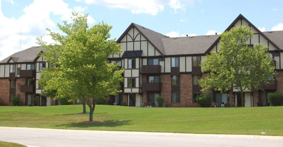 Green Spaces With Mature Trees at West Wind Apartments, Fort Wayne