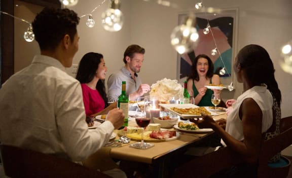 Friends Enjoying Dinner at VERSUS, Alberta