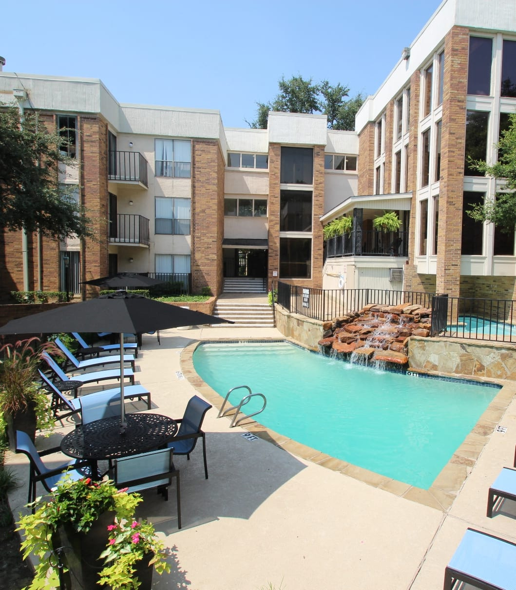This is a picture of the main pool area at Cambridge Court Apartments in Dallas, TX.