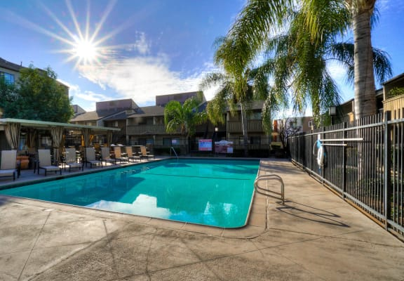 Poolside Sundeck With Relaxing Chairs at Highlander Park Apts, Riverside, California