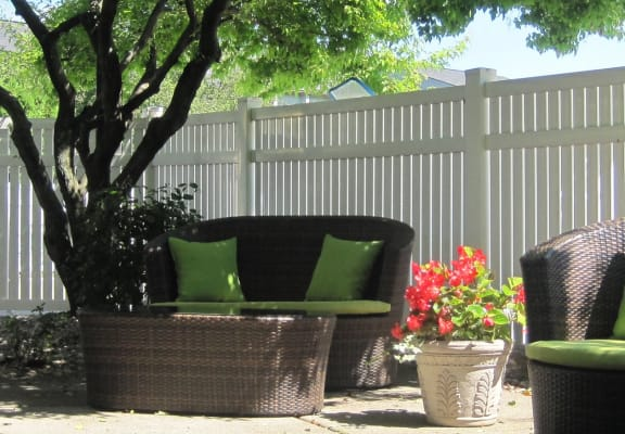 Clubhouse Patio With Available WiFi at Three Oaks Apartments at 4154 Three Oaks Boulevard