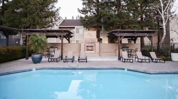 Pool and lounge chairs  l Autumn Ridge Apartments in Citrus Heights, CA