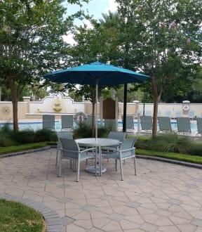 Poolside table and umbrellas | Grandeville on Saxon